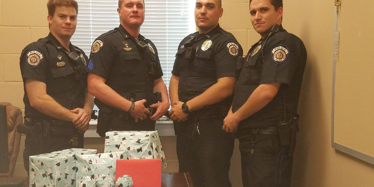 Moss Point police officers become real life Santas