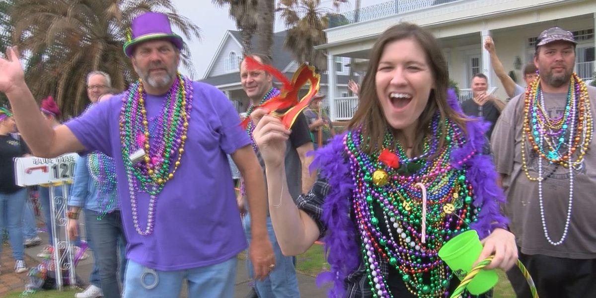 Thousands brave the rain for Pass Christian St. Paul's Carnival Association parade