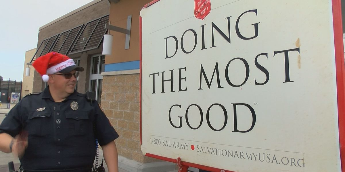 Police officers ring Salvation Army bell for friendly competition