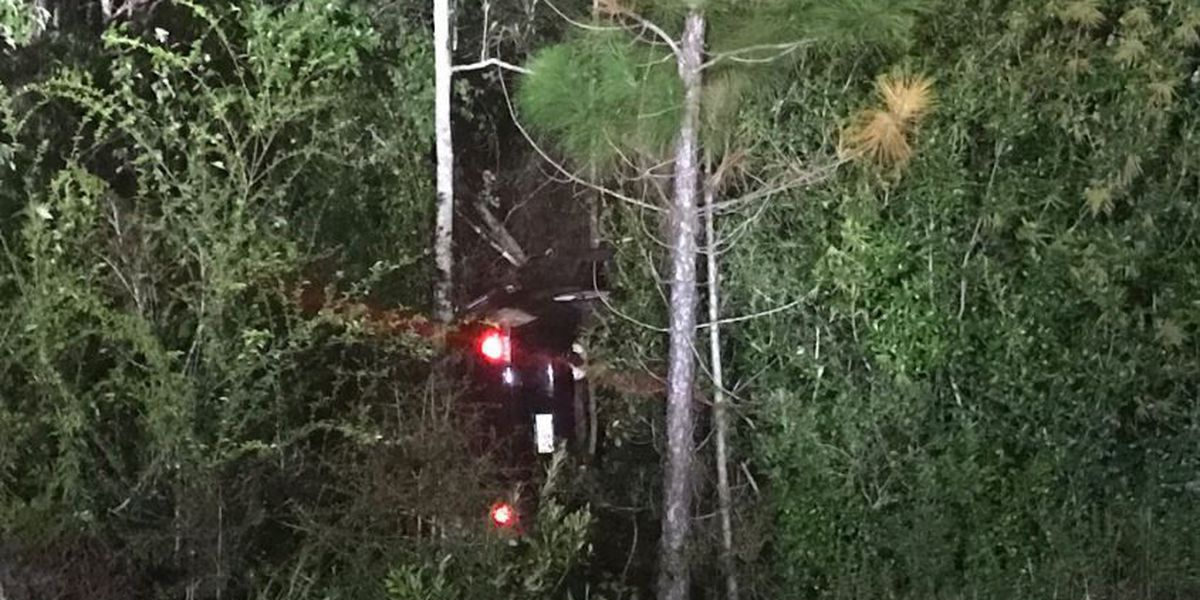 Cyclist discovers 2 people trapped after crash