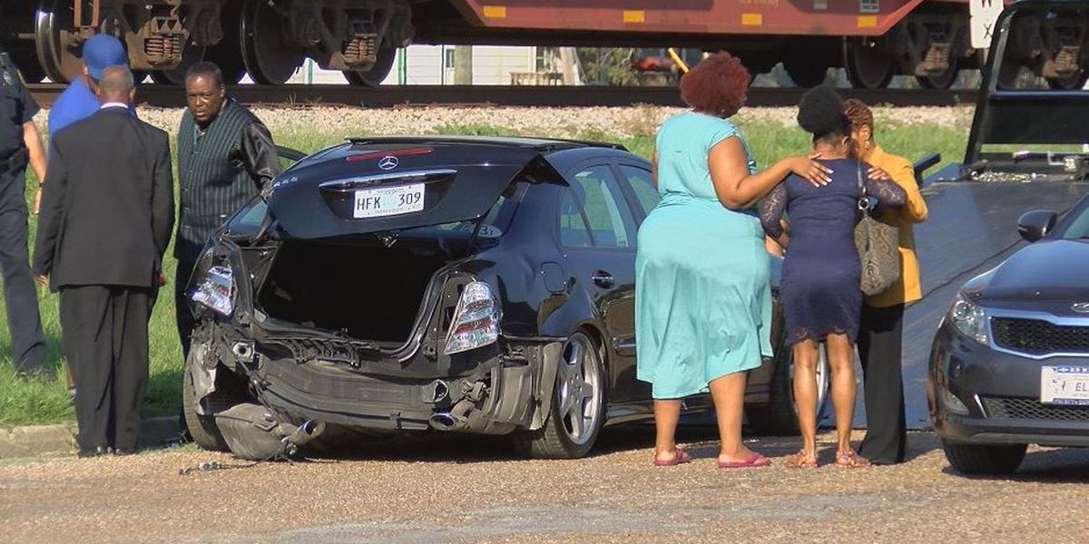 Car clipped by train; residents say change is needed