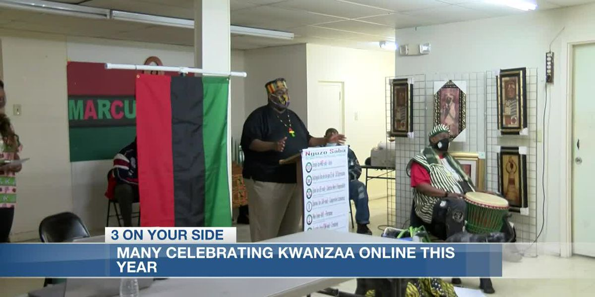 Community in Jackson lights candle for the first night of Kwanzaa