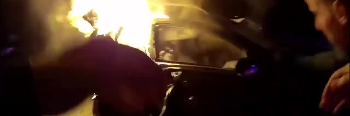 Police, civilians save men from burning vehicles