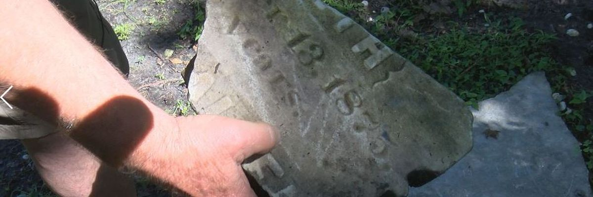 Waveland man finds 18 tombstones in backyard, one dating back to 1800s