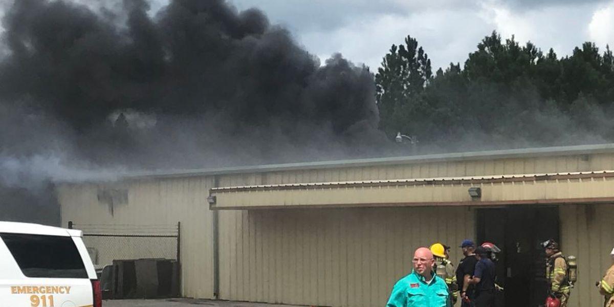Fire burns through golf cart business in Hancock County
