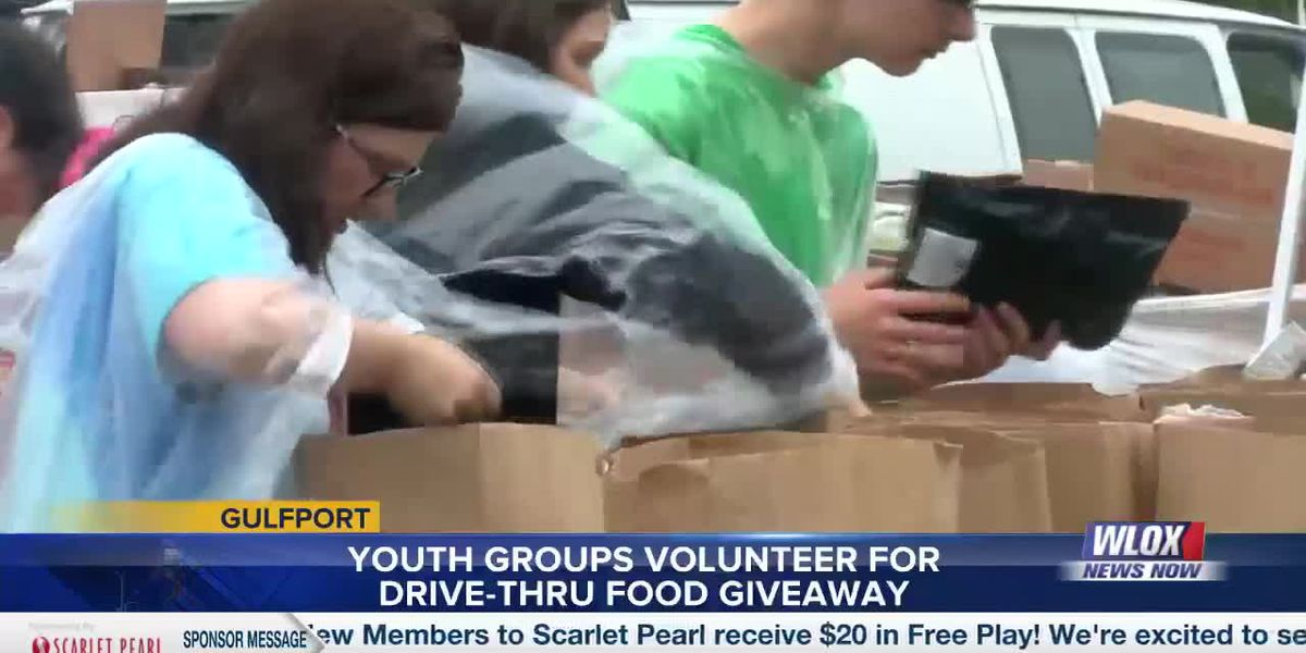 Gulfport youth groups volunteer at drive-thru pantry