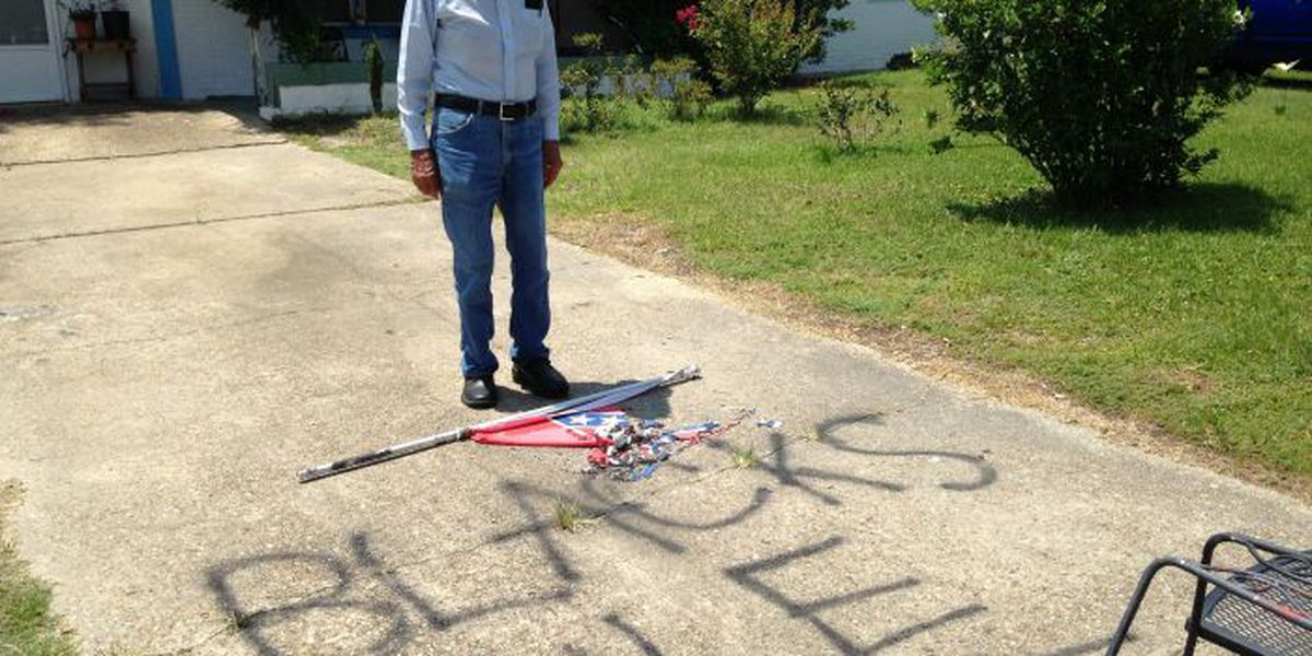 Man discovers burnt MS state flag, racial graffiti in front of his Pascagoula home