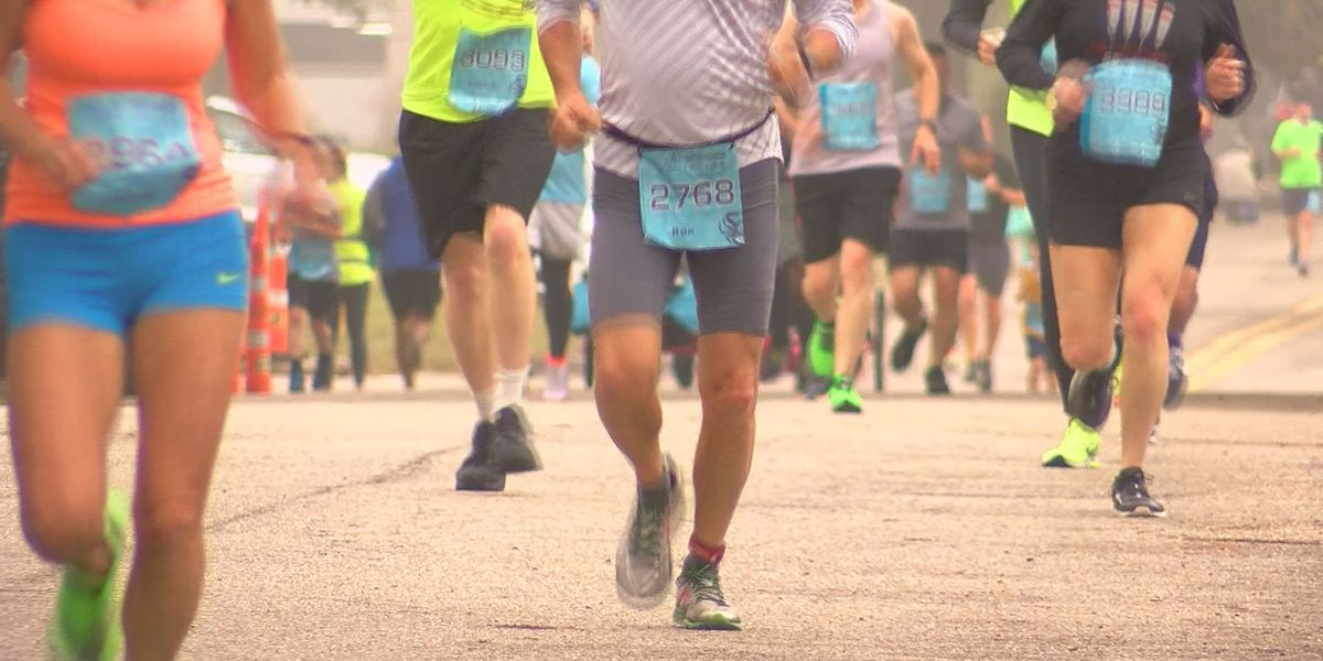Runners takeover Hwy 90 during Gulf Coast Marathon Weekend