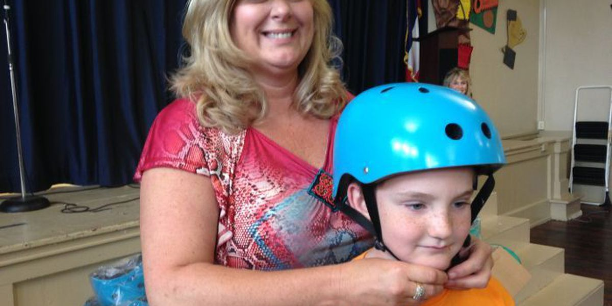 Hundreds of Harrison Co students receive free safety helmets