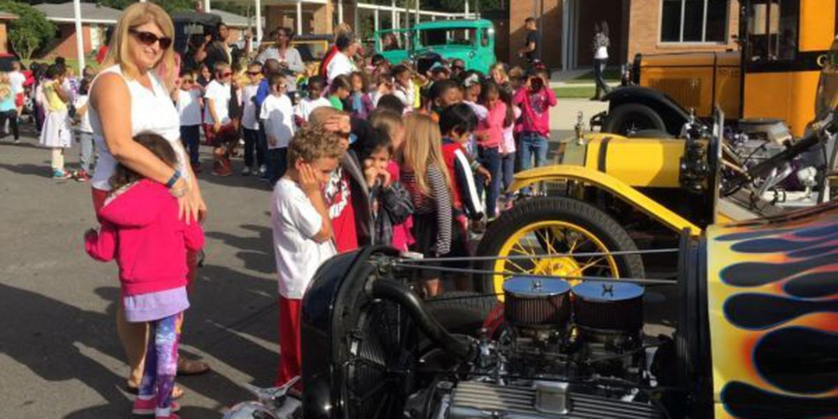 Biloxi elementary students get up close look at classic cars