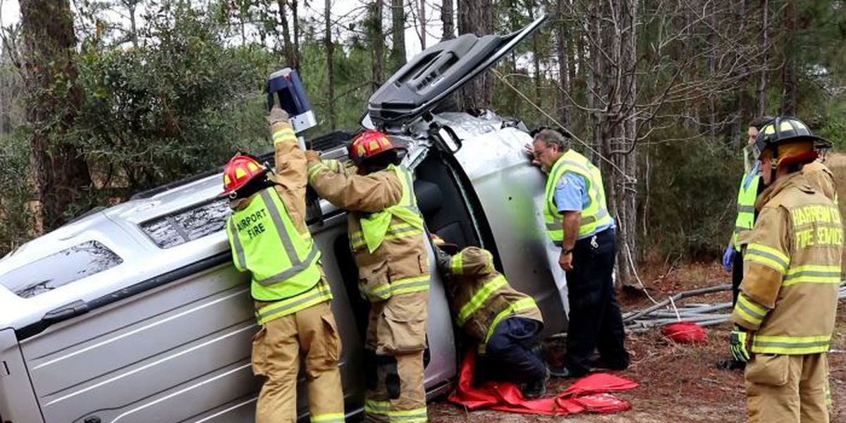 Firefighters dismantle SUV to free trapped driver