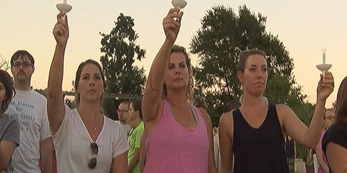 Candlelight vigil sends short, but powerful message to stop abuse