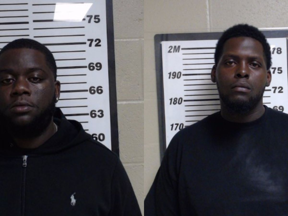 Two charged with shooting into a vehicle in Gulfport