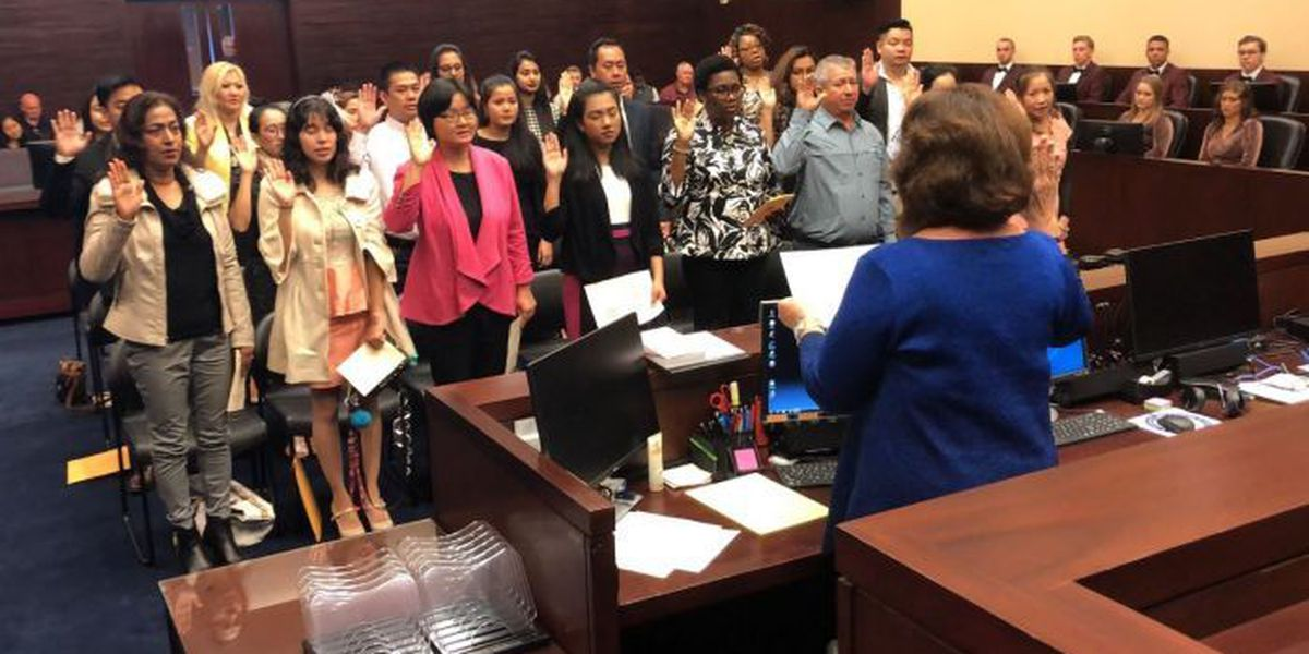 23 people become naturalized U.S. citizens