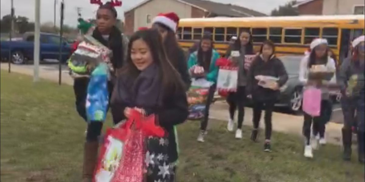 Biloxi High students spread Christmas cheer by delivering presents