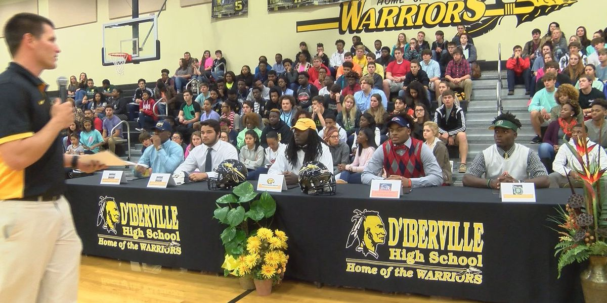 Local high school football players sign on the dotted line on National Signing Day
