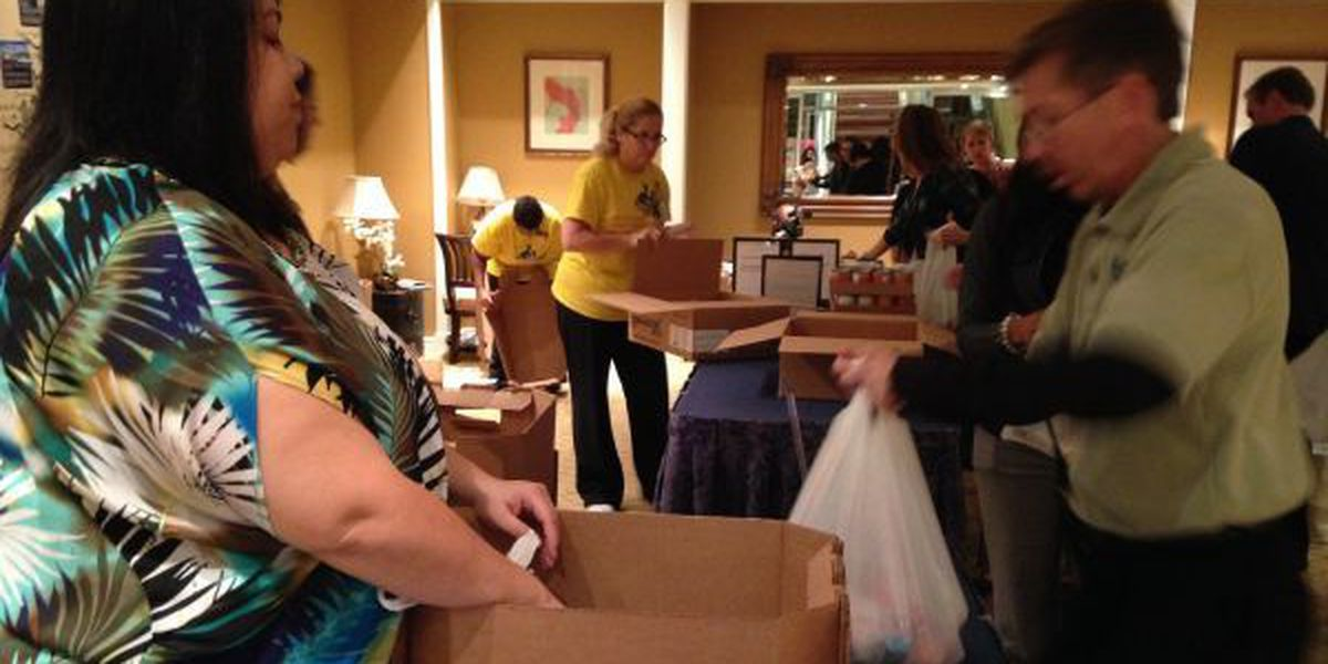 Casino employees pack 1,000 bags with food for needy children
