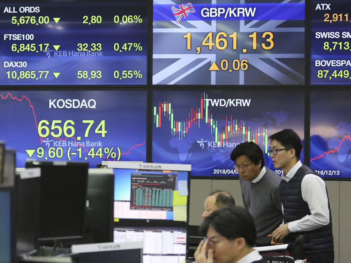 World stocks mixed ahead of Brexit address; Fed in focus