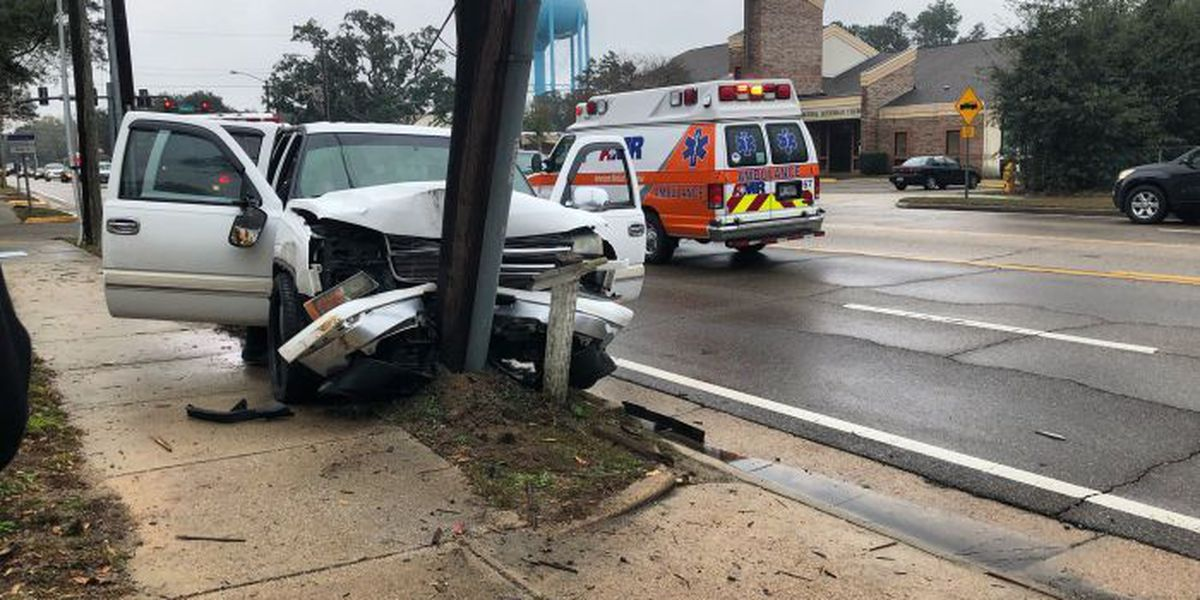 Truck slams into power pole on Pass Road
