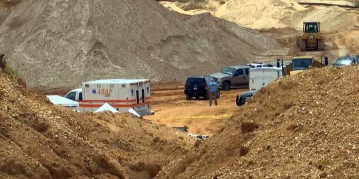 1 of the men trapped in gravel pit found dead overnight