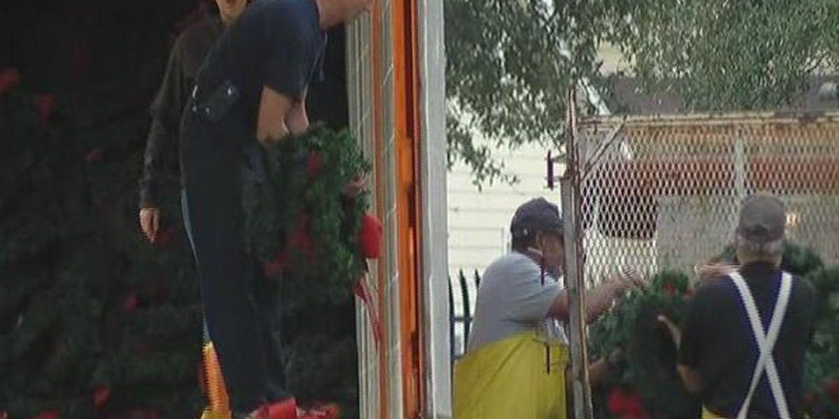 Volunteers clear veterans' wreaths at Biloxi National Cemetery