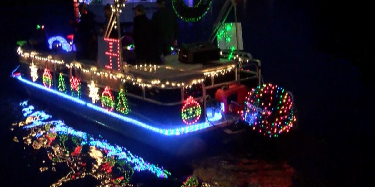 Boats light up the Tchoutacabouffa River for the holidays