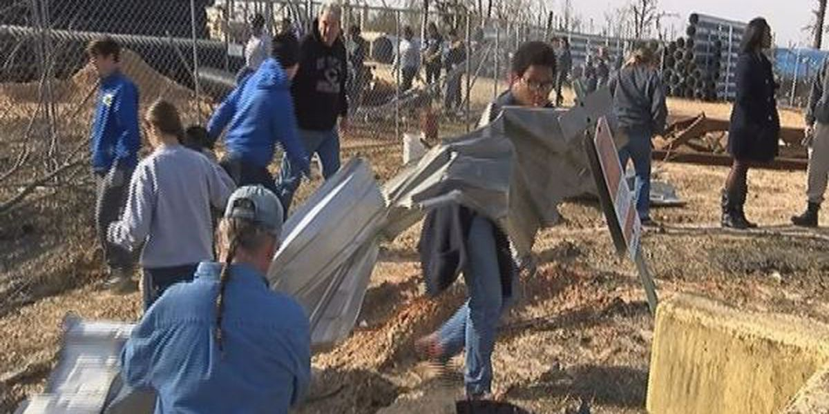 Columbia High students give a hand to clean up tornado destruction