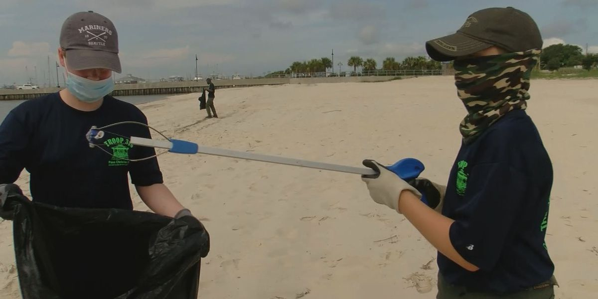 Boy Scouts clean up Fourth of July debris from Pass Christian beach