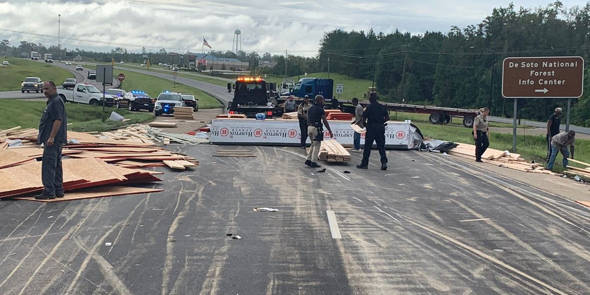 Hwy. 49 back open in Wiggins after truck overturns, spilling lumber