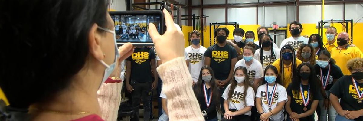 D'Iberville High School's powerlifting team lifts up two state title trophies