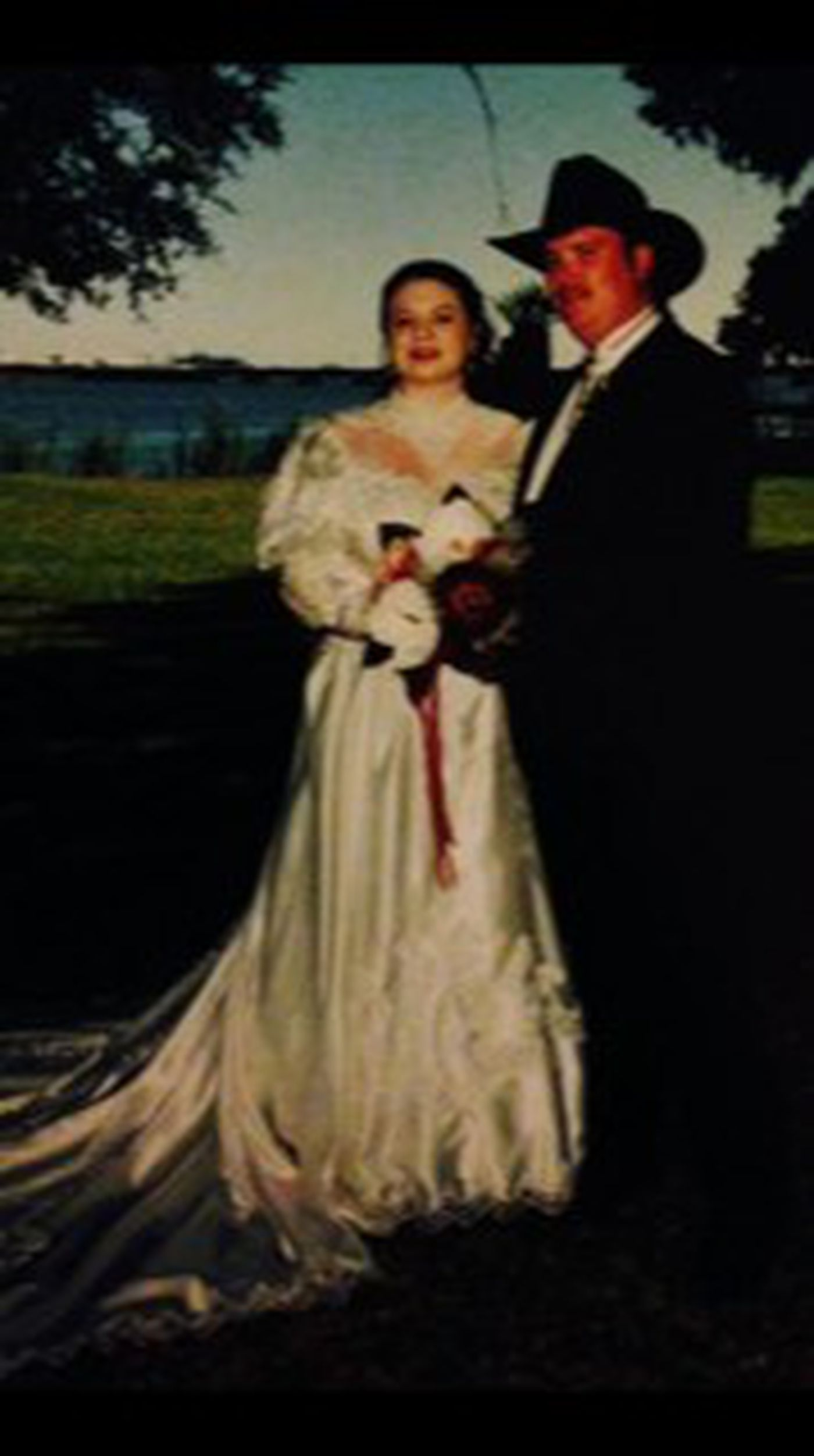 Eric and Lisa, pictured here on their wedding day, spent 25 years together.