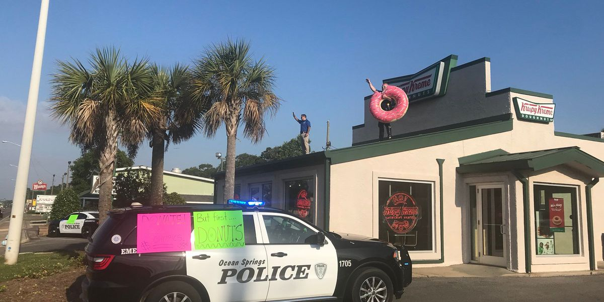 Cops dance across the rooftops of donut shop