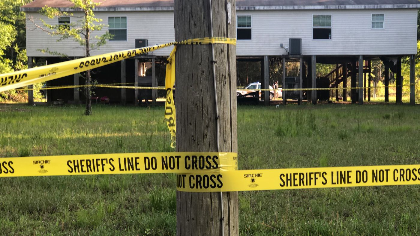 Crime scene surrounded the Bayside Park home Monday evening after a convicted felon and fugitive was shot trying to flee from Hancock County deputies.