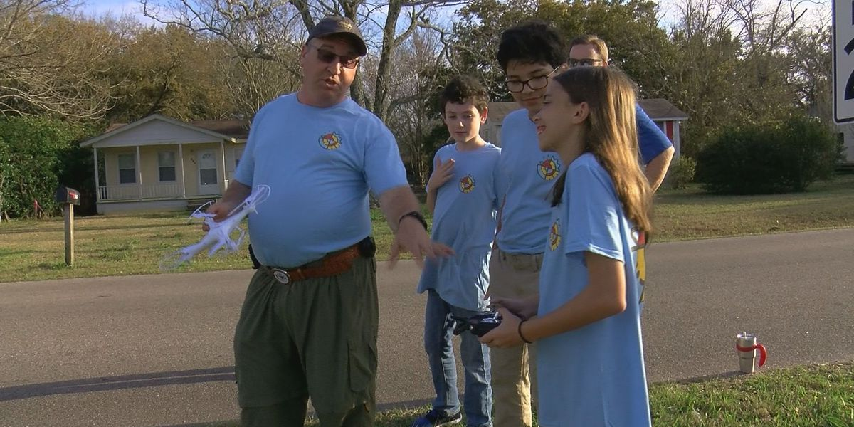 STEM scouts look at possible dangers at an intersection in Long Beach