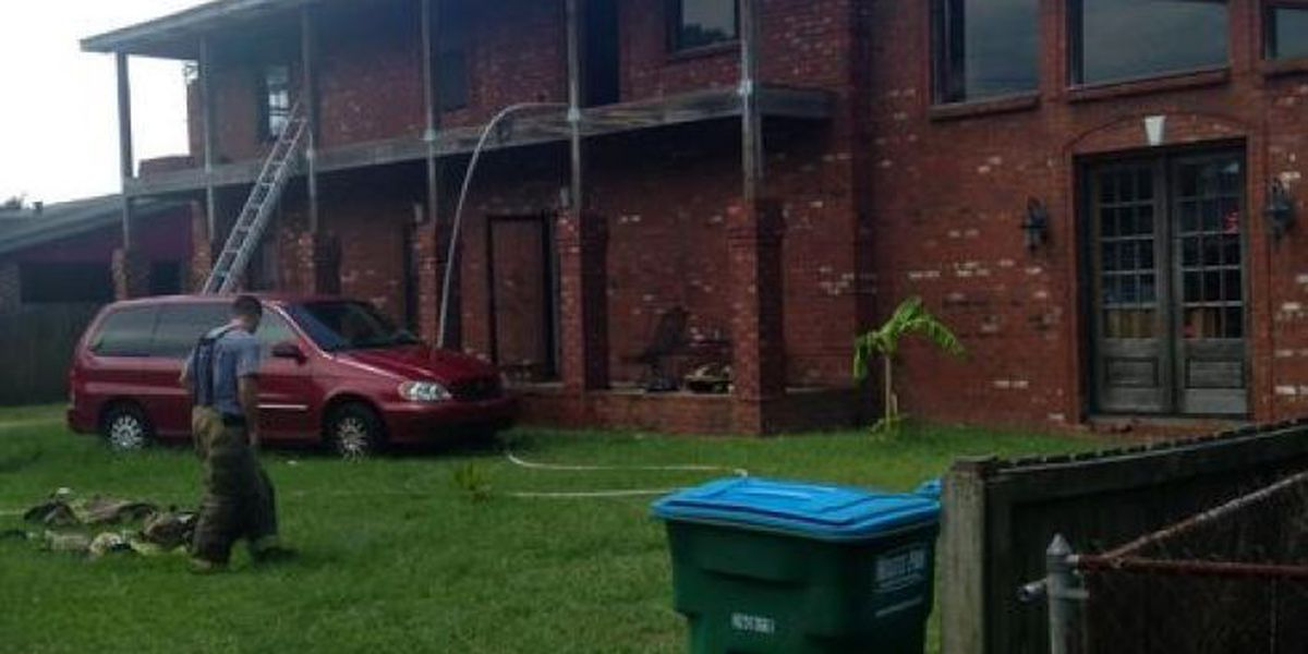 Moss Point family returns from Oklahoma to house fire