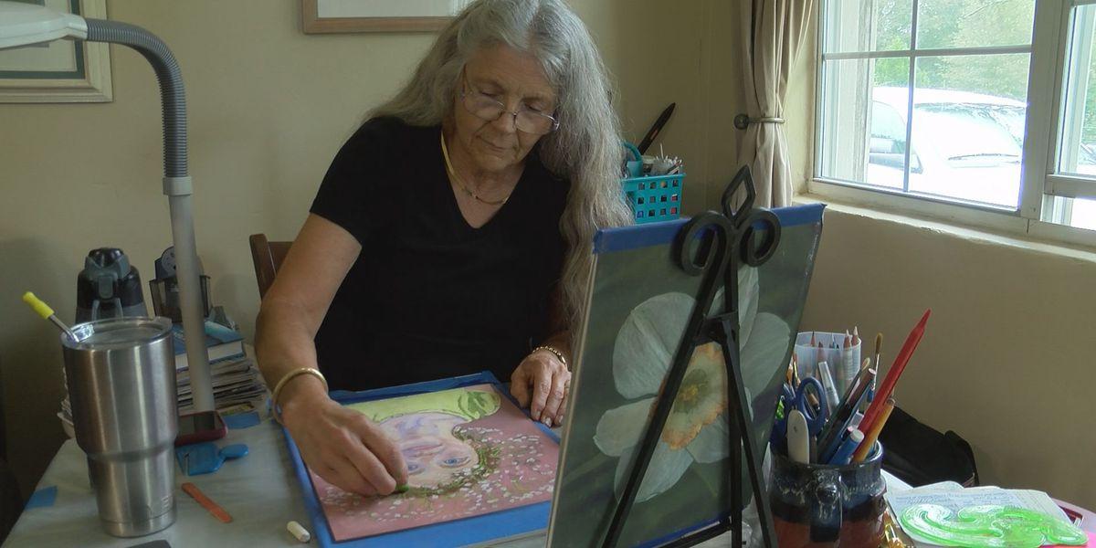 Domestic violence survivor finds healing through service dog and art