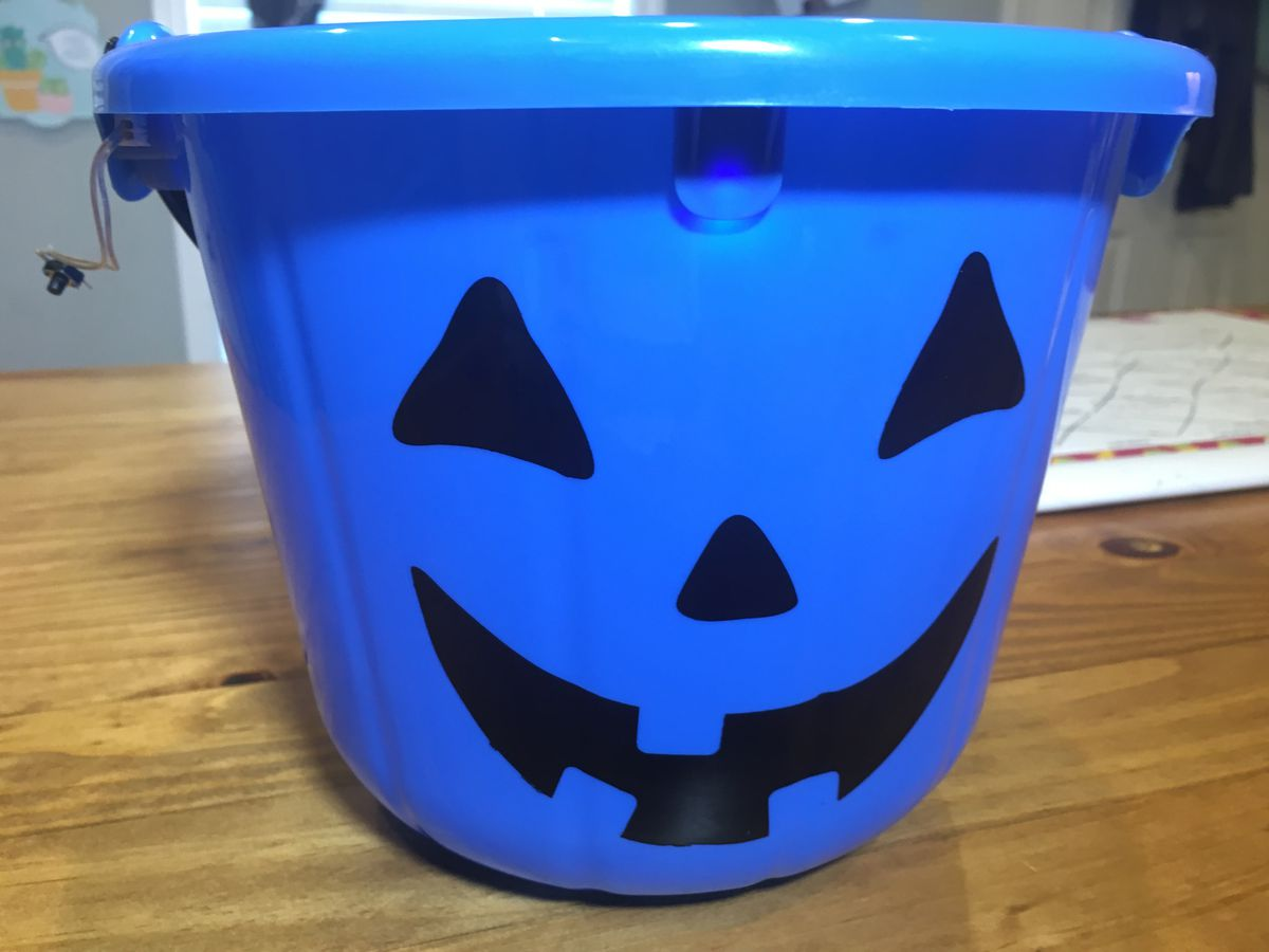 Trick-or-treating with blue buckets gaining popularity among children with autism