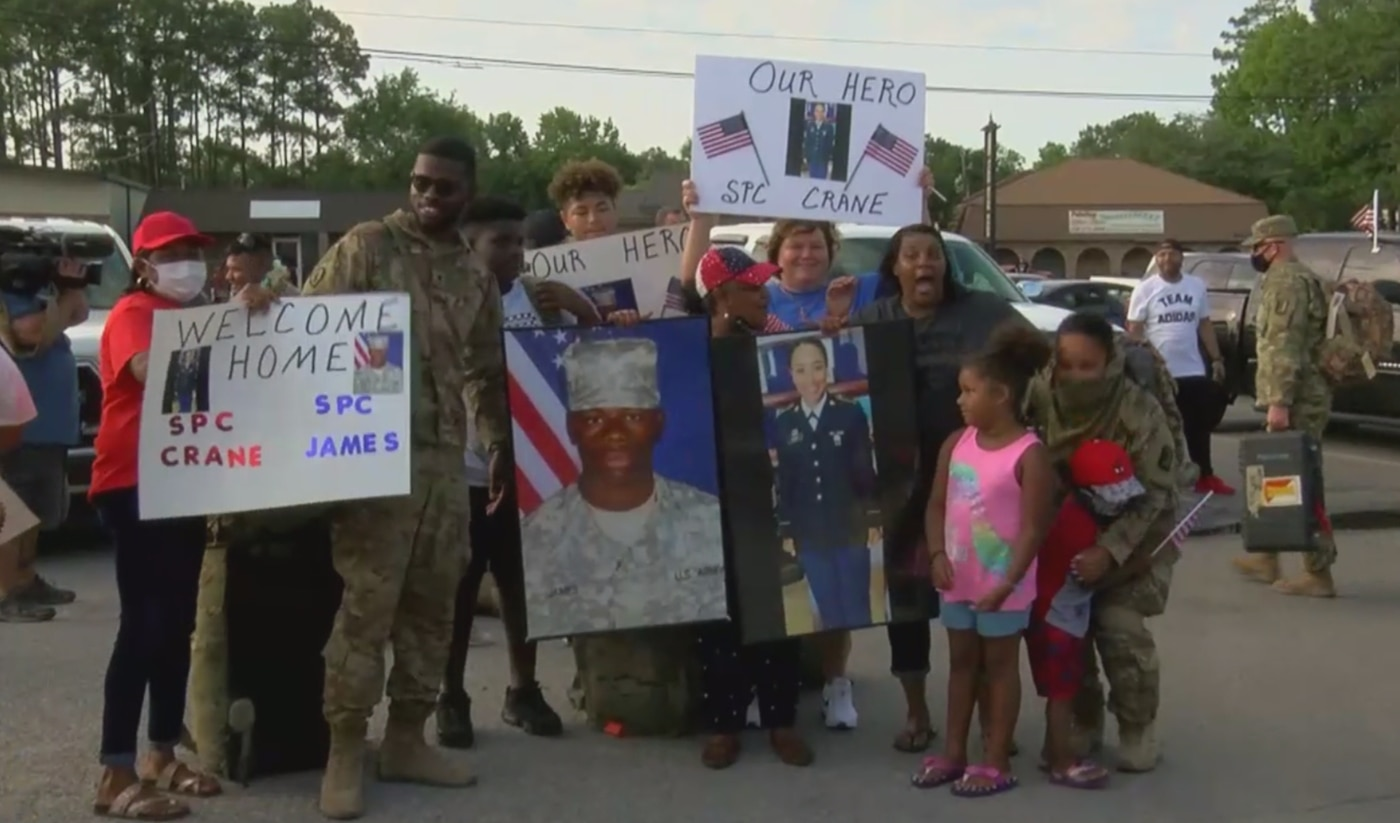 Family members gathered outside the gate of the National Guard Armory in Pascagoula to welcome home their loved ones.