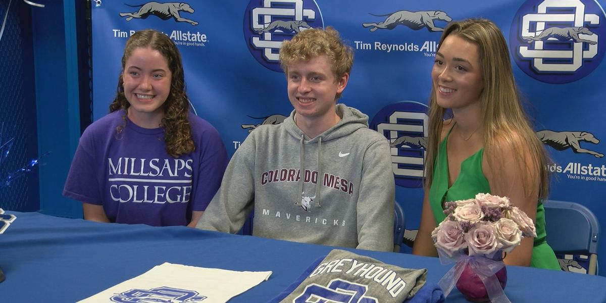 Ocean Springs celebrates trio of swimmers on signing day