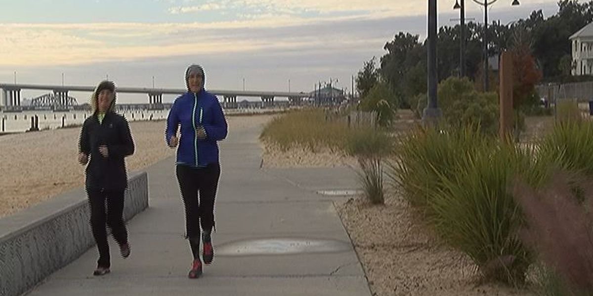 People bundle up to exercise in chilly conditions